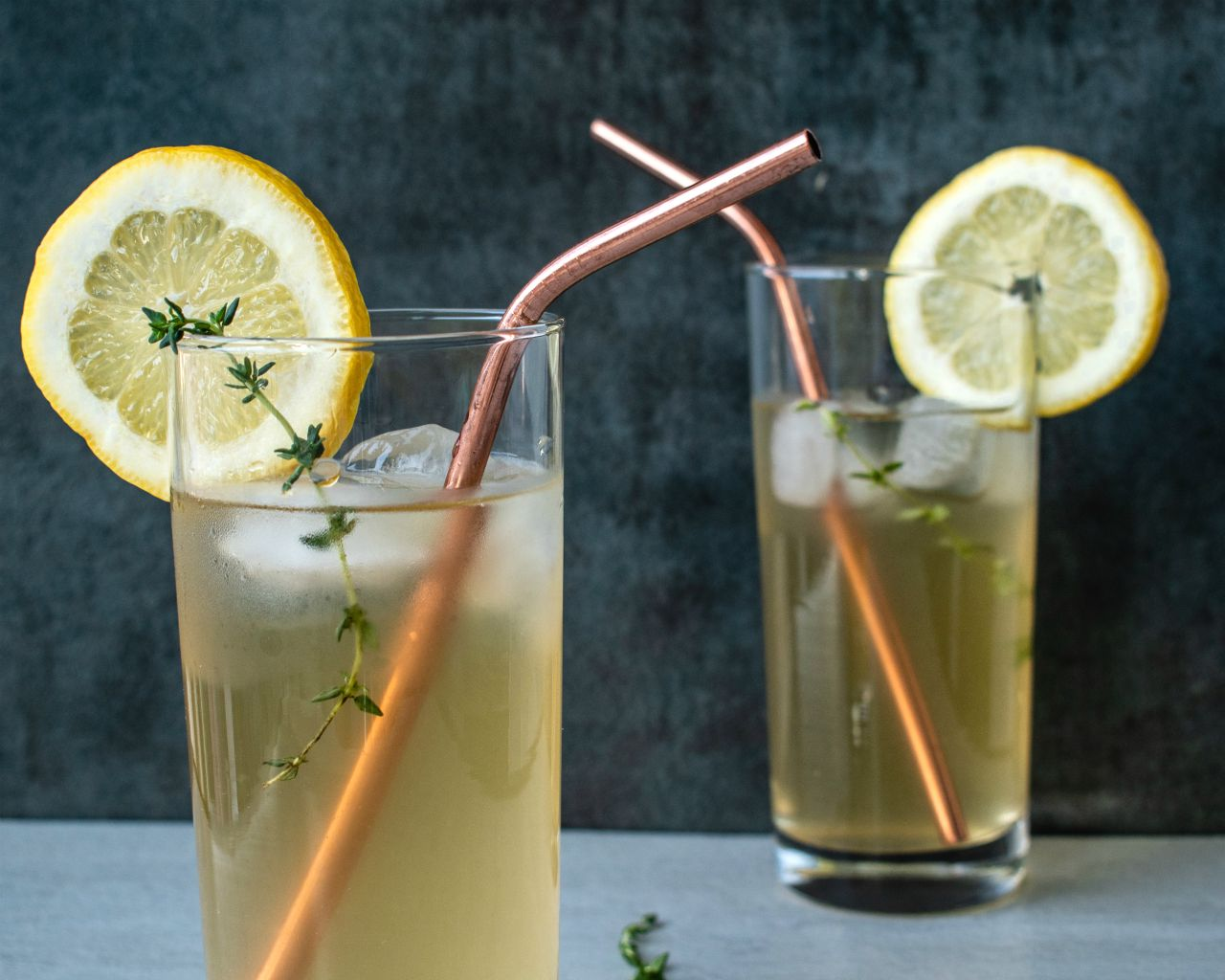 lemonade glasses with lemon slices and straw