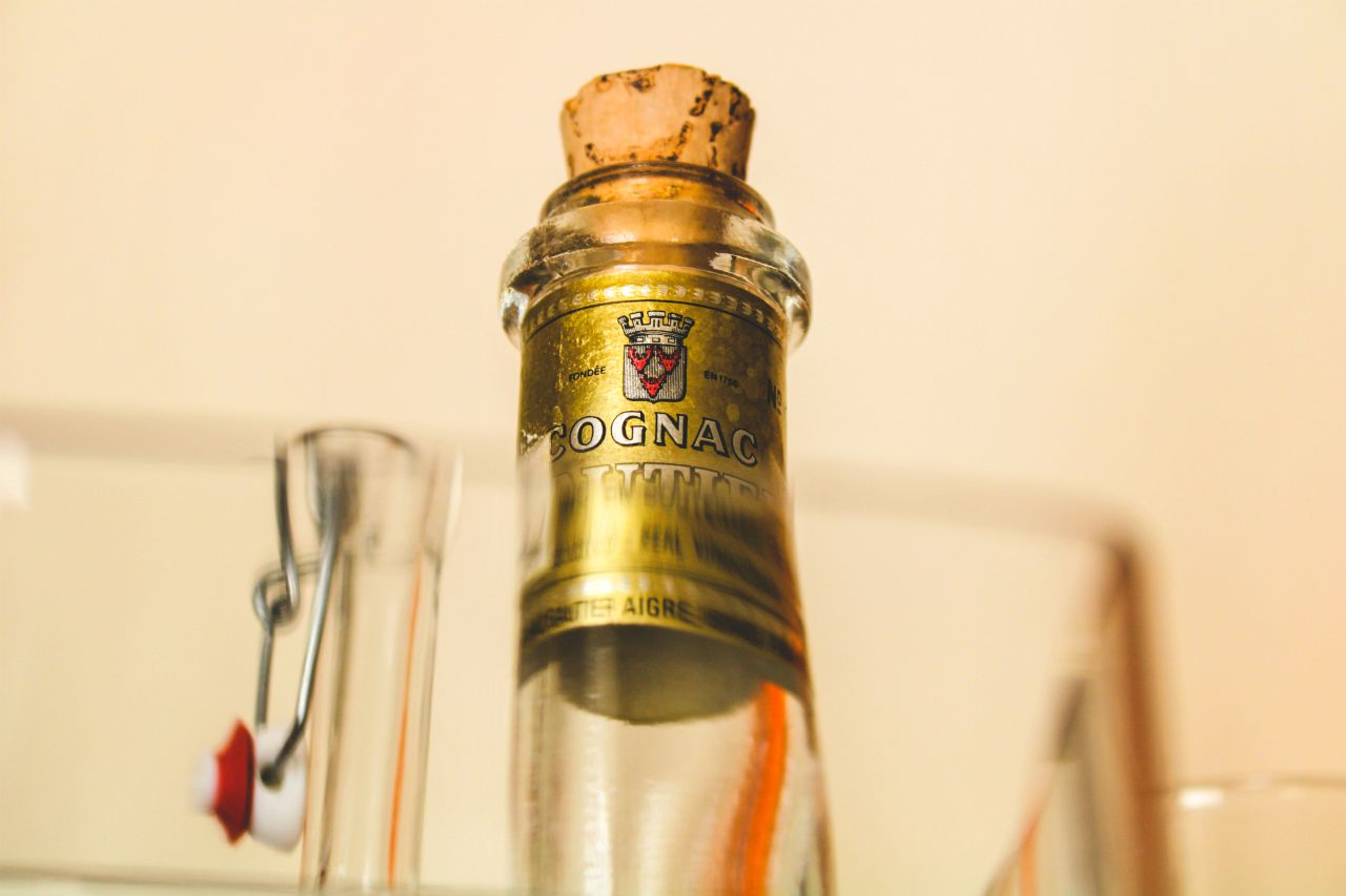 bottle of cognac with cork on