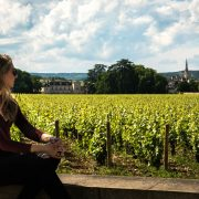 woman looking at vineyard in france