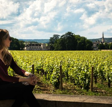woman looking at vineyard in france