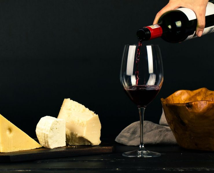 different cheese types with glass of red wine