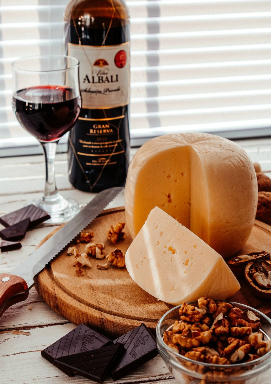 cheese block with bottle and glass of red wine